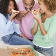 Family Eating Pizza Together — Stock Photo #4780881