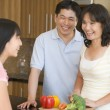 Stock Photo: Family Laughing While Preparing meal,mealtime