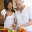 Stock Photo: Mother And Daughter Preparing meal,mealtime Together