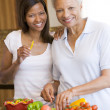 Mother And Daughter Preparing meal,mealtime Together — Stock Photo
