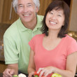 Husband And Wife Preparing meal,mealtime Together — Stock Photo #4780986