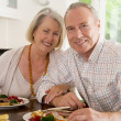 Stock Photo: Elderly Couple Enjoying meal,mealtime Together
