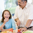 Grandfather And Granddaughter Preparing meal,mealtime Together — Stock Photo
