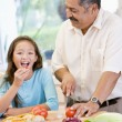 Stock Photo: Grandfather And Granddaughter Preparing meal,mealtime Together