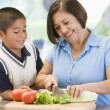 Stock Photo: Grandmother And Grandson Preparing meal,mealtime Together