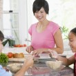 Children Enjoying Breakfast While Mother Is Preparing Food — Stock Photo