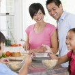 Family In Kitchen Eating Breakfast — Stock Photo