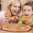 Stock Photo: Mother And Son Eating PizzTogether