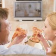 Couple Enjoying Pizza In Front Of TV — Stock Photo