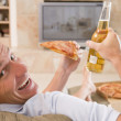 Man Enjoying Beer And Pizza In Front Of TV — Stock Photo