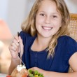 Stock Photo: Young Girl Eating meal,mealtime