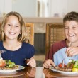 Stock Photo: Brother And Sister Eating meal, mealtime Together