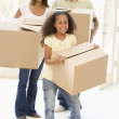 Family moving into new home smiling — Stock Photo