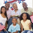 Foto Stock: Family in living room on fourth of July with flags and cookies s