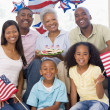 Family in living room on fourth of July with flags and cookies s — Stok Fotoğraf #4781413