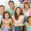 Family in living room on fourth of July with flags and cookies s - Zdjcie stockowe