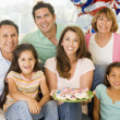 Family in living room on fourth of July with flags and cookies s - Lizenzfreies Foto