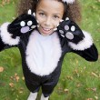 Young girl outdoors in cat costume on Halloween — Foto de stock #4781454