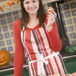 Woman in kitchen making Halloween treats and smiling — Stock Photo