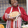 Foto Stock: Womin kitchen making Halloween treats and smiling