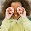Young girl at Halloween playing with treats and smiling — Stock Photo