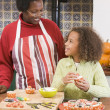 Grandmother and granddaughter making Halloween treats and smilin — Stock Photo #4781484