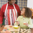 Grandmother and granddaughter making Halloween treats and smilin — Stock Photo #4781487