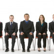 Group Of Business Sitting In A Line — Stock Photo