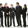 Stock Photo: Group Of Business Standing Around Conversing