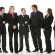 Group Of Business Standing Around Conversing — Stock Photo