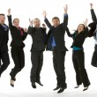 Group Of Business Jumping In The Air - Stock Photo