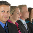 Group Of Business In A Line Looking — Stock Photo #4781576
