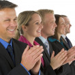 Group Of Business In A Line Smiling And Applauding — Stock Photo