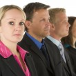 Group Of Business In A Line Looking Serious — Stock Photo #4781583