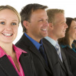 Group Of Business In A Line Smiling — Stock Photo #4781584