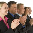 Group Of Business In A Line Smiling And Applauding — Stock Photo #4781585