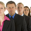 Group Of Business In A Line Looking Serious — Stock Photo #4781586