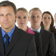 Group Of Business In A Line Looking Serious — Stock Photo