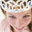 Royalty-Free Stock Photo: Teenage girl wearing crown and smiling