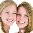 Two girl friends together smiling - Stockfoto