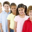 Row of five young friends smiling - Stock Photo