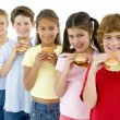 Row of five young friends eating hamburgers - Stock Photo