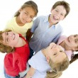 Circle of five young friends smiling — Stock Photo #4781968