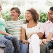 Group Of Teenagers Sitting On A Couch — Stock Photo #4782181