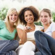 Stock Photo: Teenage Girls Sitting On Couch