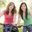 Stock Photo: Teenage Girls On Bicycles