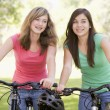 Foto Stock: Teenage Girls On Bicycles