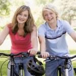 Teenage Boy And Girl On Bicycles — Stock Photo #4782237