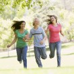 Teenagers Running Through Park — Stock Photo #4782265
