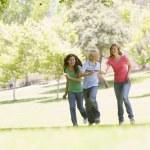 Teenagers Running Through Park — Stock Photo #4782266